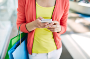 Shopper with cellphone